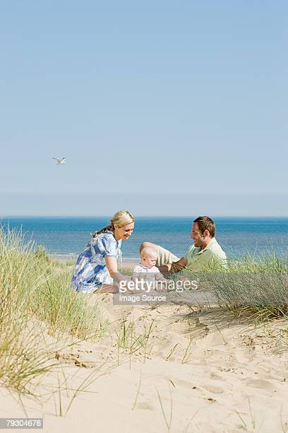 Family sat on the beach