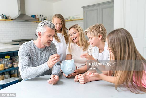 Family saving money in a piggybank