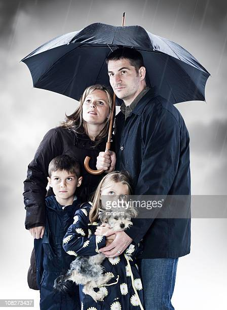 family seeking shelter from the storm - terrified stock pictures, royalty-free photos & images