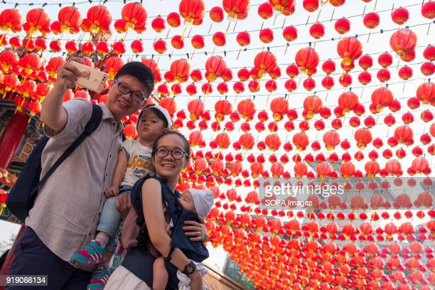 A family seen taking a selfie at the Thean Hou Temple on the first day of Chinese New Year Chinese New Year is the first day of the New Year in the...