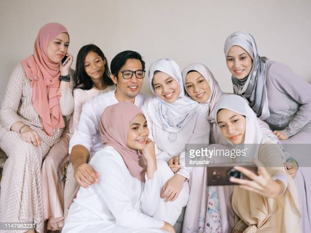 family selfie and laughing - hari raya celebration stock pictures, royalty-free photos & images