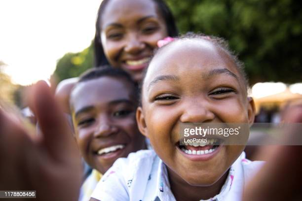 family selfie at the park - african american ethnicity stock pictures, royalty-free photos & images