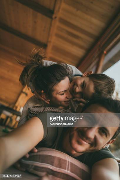 family selfie from winter vacation - vertical stock pictures, royalty-free photos & images