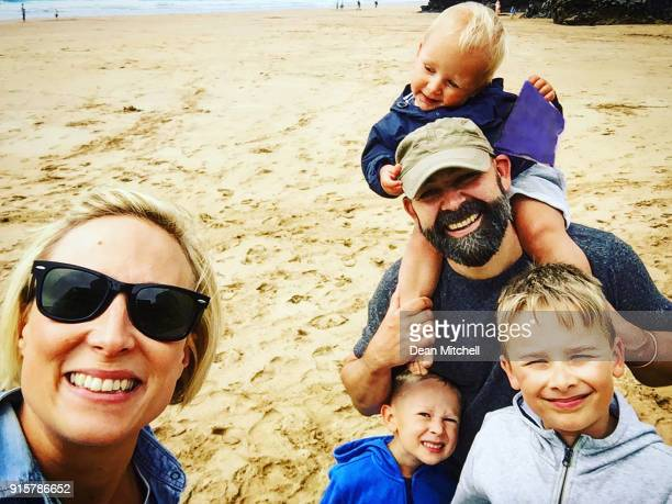 family selfie on the beach - taken on mobile device stock photos and pictures