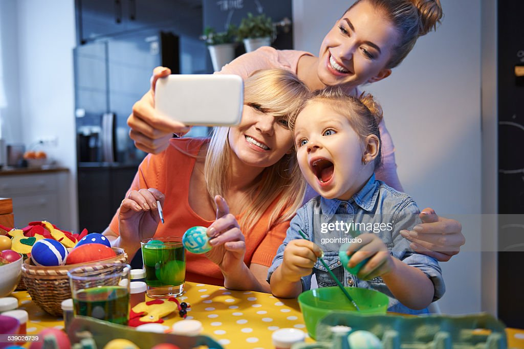 Family selfie with Easter eggs : Stock Photo