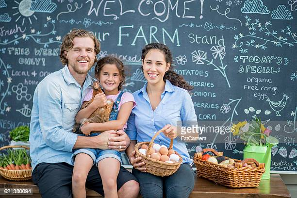 family selling their chickens eggs - farm to table stock photos and pictures