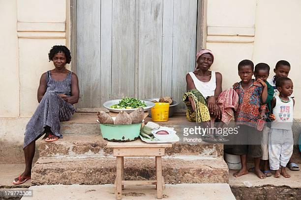 Family selling vegetables in front of their house