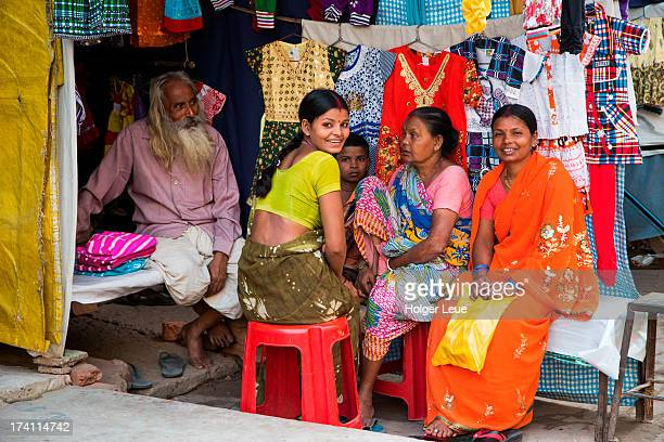 Family sells clothes at market stand