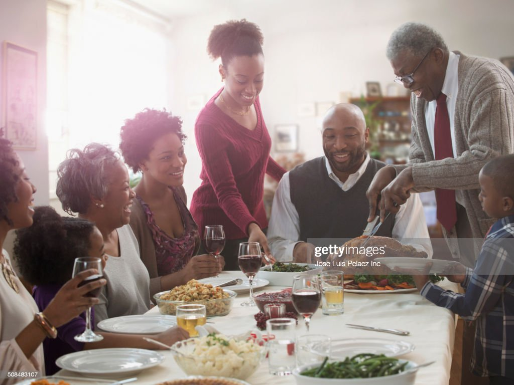 Family serving each other at holiday table : Stock Photo