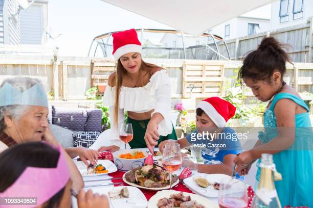 Family serving food at Christmas lunch