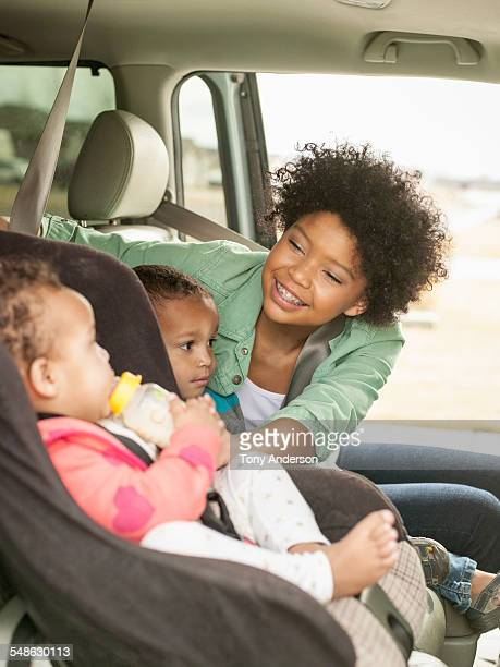 family settling into car for roadtrip. - idaho dairy stock photos and pictures