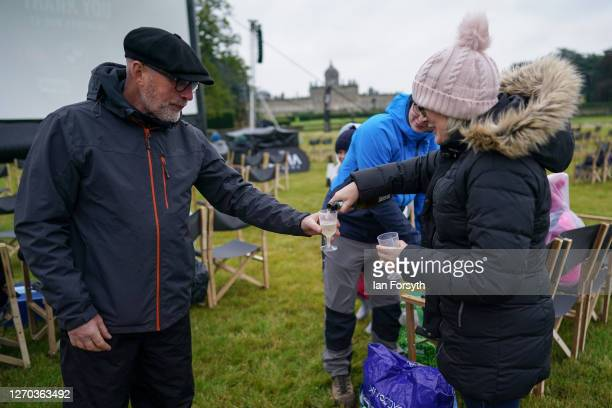 Family share a bottle of champagne as members of the public attend a screening of The Greatest Showman during the Luna Cinema movie experience at...