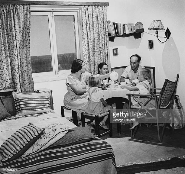 A family share a meal in their room at a kibbutz Israel circa 1950 The family shares a single room with the children sleeping in a communal dormitory