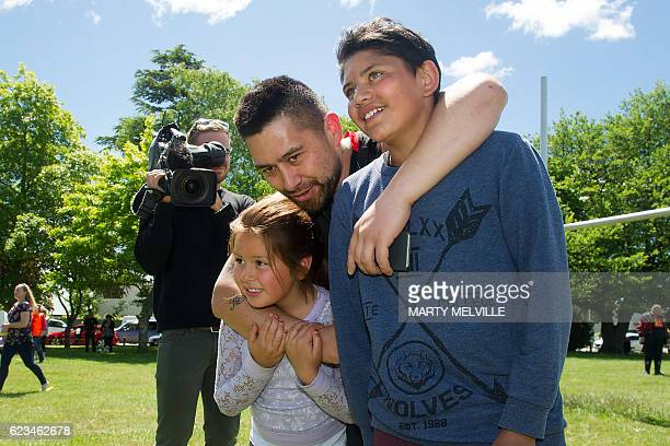 A family shares a hug after the children were evacuated by air force helicopter from Kaikoura to Christchurch on November 16 after an earthquake hit...