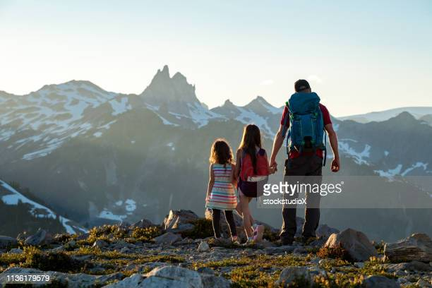 family sharing a love for the great outdoors - whistler british columbia stock pictures, royalty-free photos & images