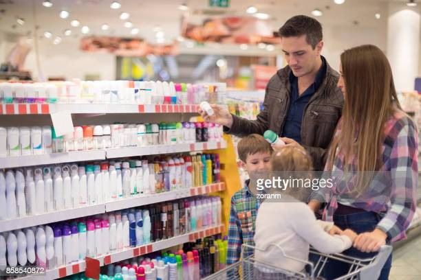 family shopping for cosmetics - toiletries stock pictures, royalty-free photos & images
