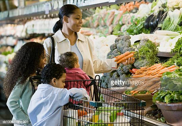 Family shopping for groceries in supermarket