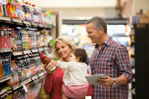 Family shopping for juice in supermarket - gettyimageskorea