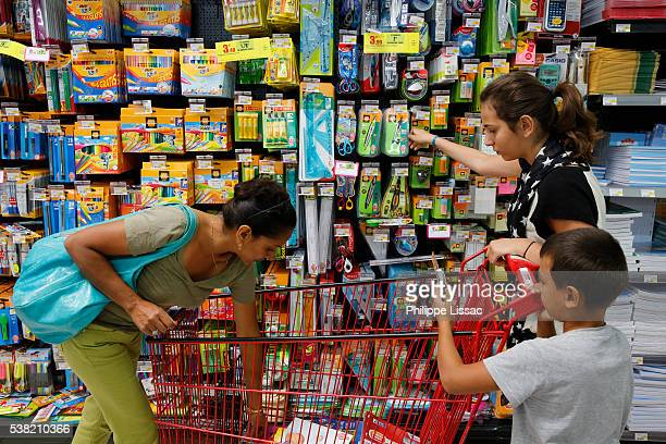 Family shopping for school supplies in a supermarket