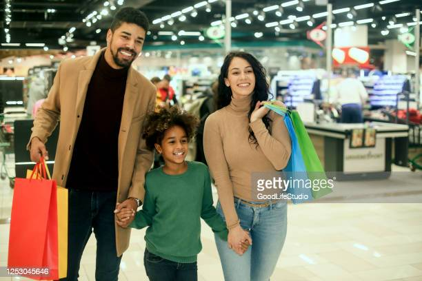 family shopping in a supermarket - small group of people stock pictures, royalty-free photos & images