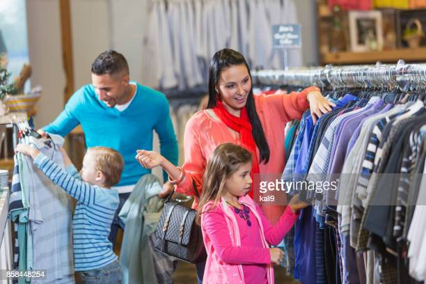 Family shopping in clothing store