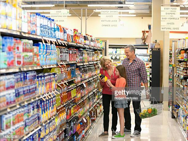 family shopping in supermarket - cold drink stock pictures, royalty-free photos & images
