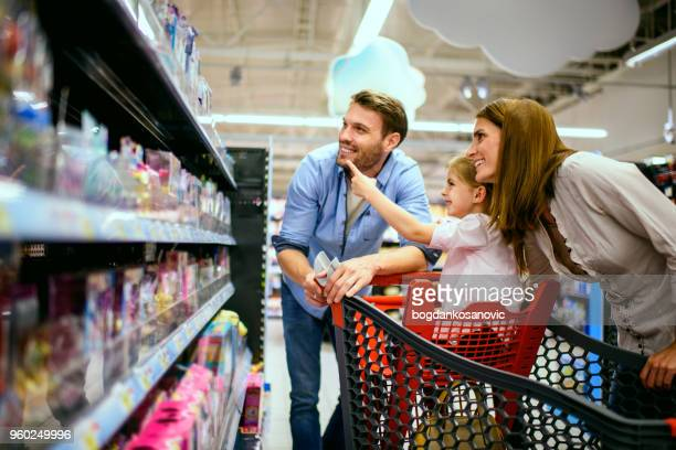 family shopping - toy stock pictures, royalty-free photos & images