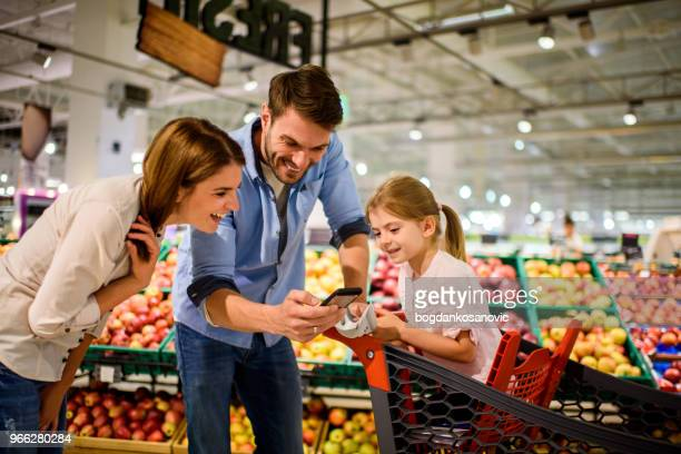 family shopping - blackberry fruit stock pictures, royalty-free photos & images