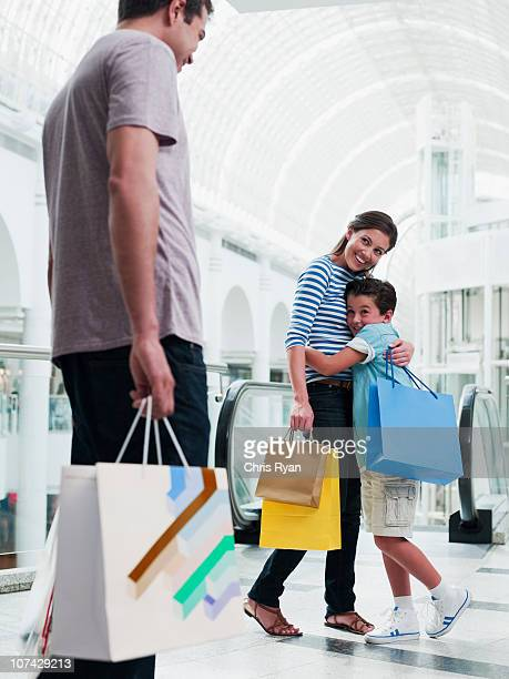 Family shopping together in mall