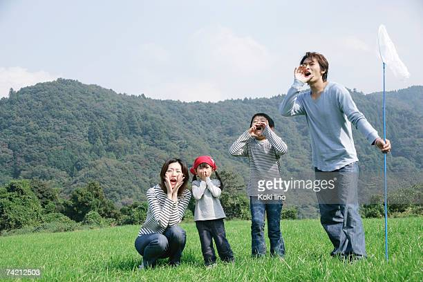 Family shouting in meadow