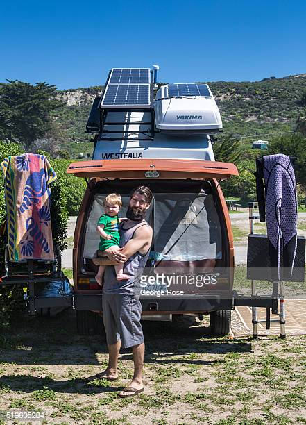 A family shows off their Volkswagen Westfalia popup camper rigged with solar panels on the roof on March 16 2016 near Jalama Beach California After...