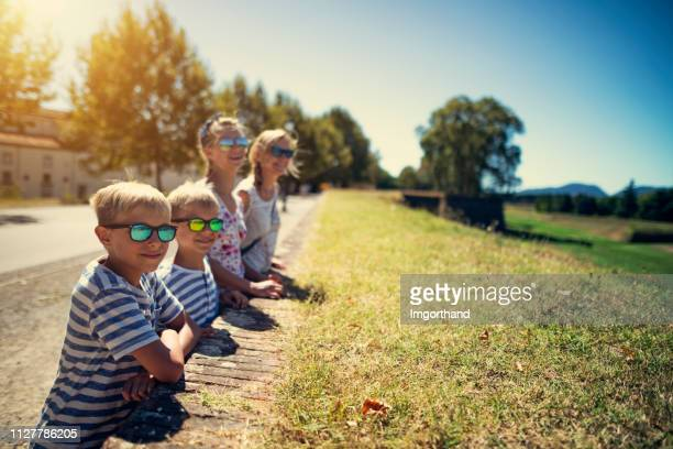 family sightseeing italian town of lucca, tuscany - fortified wall stock photos and pictures