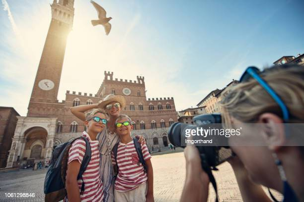 family sightseeing siena, italy - siena italy stock pictures, royalty-free photos & images
