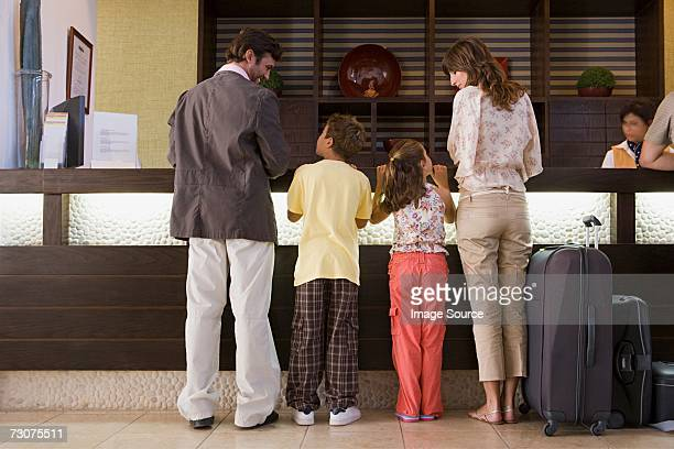 Family signing into hotel