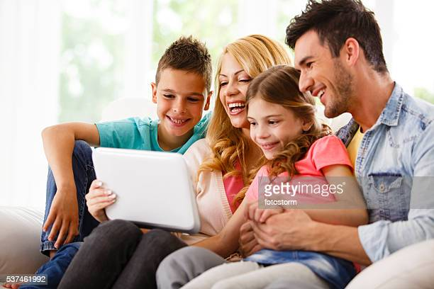 Family sing digital tablet together