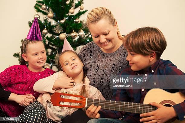 Family Singing Christmas Songs