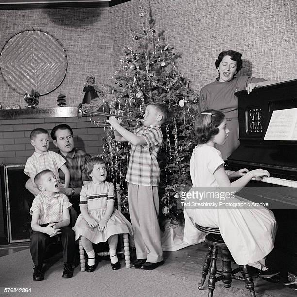 Family Sings Christmas Carols at Home