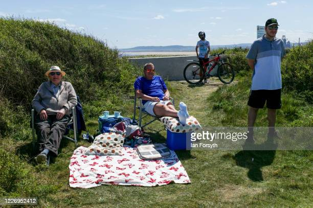 Family sit and enjoy a picnic at South Gare during warm May Bank Holiday weather on May 25, 2020 in Redcar, United Kingdom. With the easing of some...
