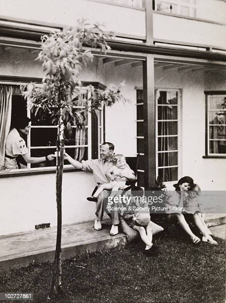 Family sit outside home 192060 Photographic archive of Photographic Advertising Limited Comprising stock sheets individual images guard books...