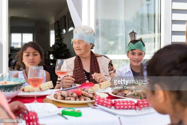 Family sits at table for Christmas lunch