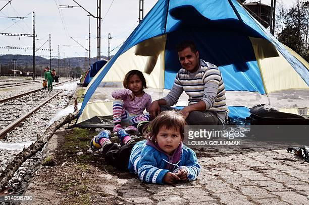 Family sits at the makeshift camp at the Greek Macedonian borders, near the village of Idomeni on March 8 where thousands of refugees and migrants...