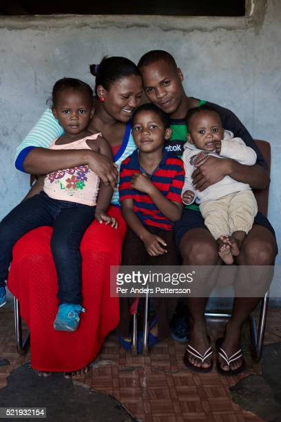 A family sits for a portrait in their house in Guguletu a township about ten miles outside Cape Town South Africa
