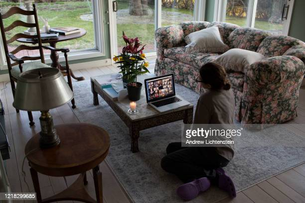 Family sits for shiva, a traditional Jewish time of mourning for the dead when friends and family gather, remotely on zoom for an elderly relative...
