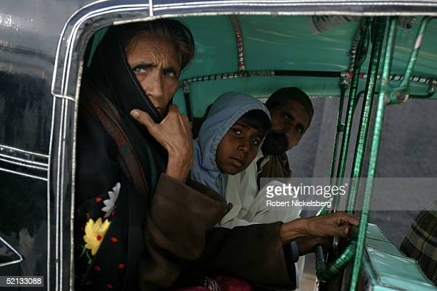 A family sits in a 3 wheel rickshaw during morning rush hour traffic in downtown Karachi Pakistan January 26 2005 Karachi is one of the world's most...