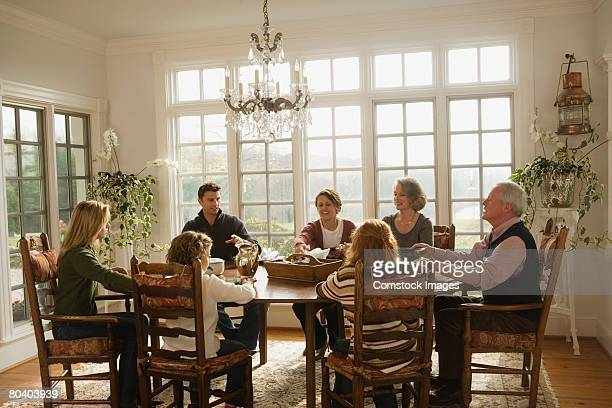 Family sitting around dining room table