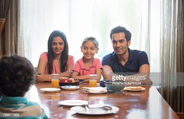 Family sitting at dinning table