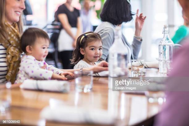 Family sitting at table in restaurant