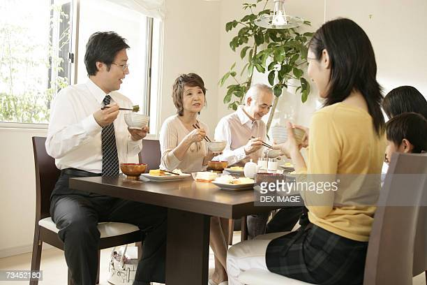 Family sitting at the dining table