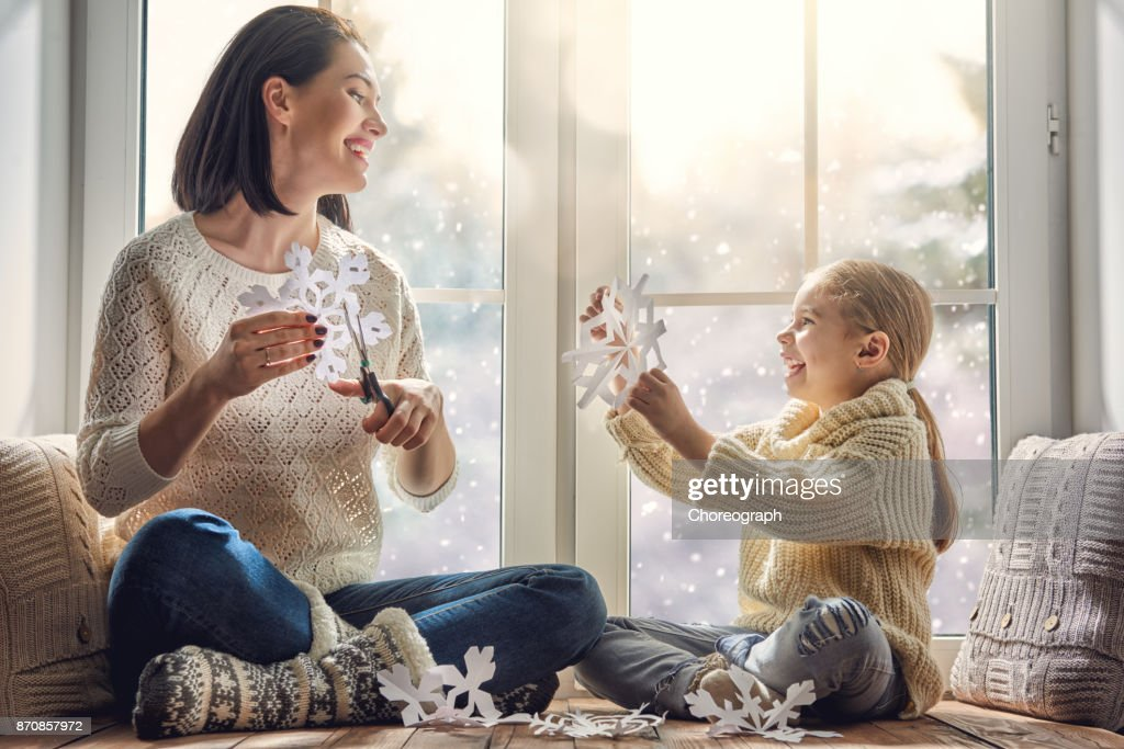 family sitting by the window : Stock Photo