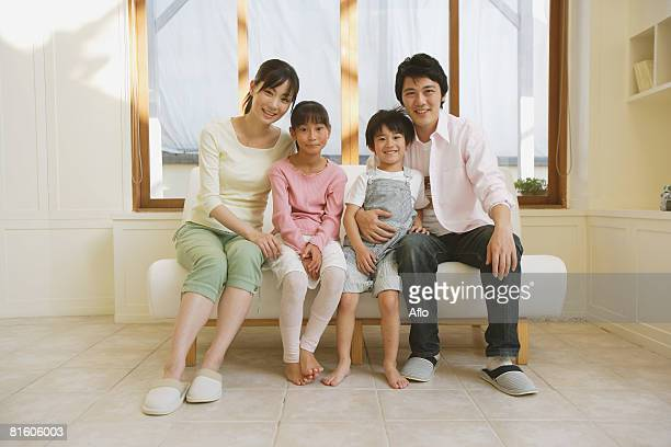 Family Sitting Down on Couch